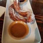 Churros with chocolate and caramel sauces