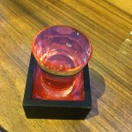 Sake - served to the brim with an overflow box