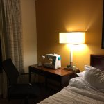 One of the bedrooms has a desk/ergonomic chair, and one lamp (other side of the bed has no lamp.
