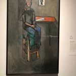 Woman on high stool