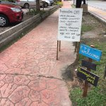 If you can't find us, look for these colorful signboards along the street at Pantai Tengah.