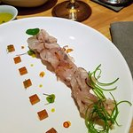 Barramundi carpaccio with orange shallot dressing & dashi jelly