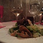 Starting option offered: Salad with crustaceans topped with sesame seeds and a glass of tamianka