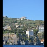 View from boat in Sorrento port of hotel on cliff top