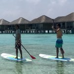 Stand up paddling on besides the water villas.