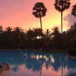 Amazing colourful sunset around the pool