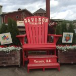 Photo op in the new Giant red Muskoka Chair, for Canada's 150 Birthday.