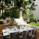 Dinner party under the pecan tree at Hotel Ella in Austin, Texas.