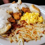 Fried chicken with biscuits and gravy, hash browns and eggs - yum