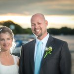 On the dock over the water. Wedding night