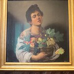 """Caravaggio's impressively detailed """"Boy with a Basket of Fruit"""""""