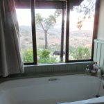 A bathroom with a view of Spioen Kop and a game reserve