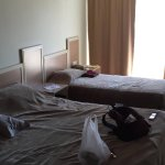 Room 113, 1 double bed and 1 single bed with a TV and small fridge. Includes balcony with great