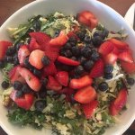 Spot Chop Salad w/ a side of strawberries & blueberries on top!