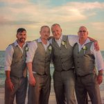 myself, two other groomsmen, and the groom on the beach after the wedding