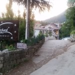 Entry to hotel from log huts road