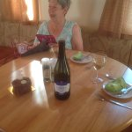 Celebrating birthday treat with wine in the lovely caravan
