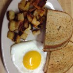 One egg, home fries and rye toast