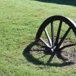 Broken wagon/cannon wheel on path leading to facility entrance