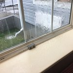 water collecting from window leaking during rainstorm