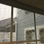 water poring in through window seal during rainstorm