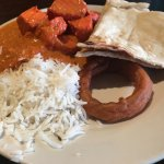 The first plate, rice, chicken tika masala, naan, onion ring