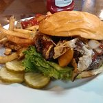 The Swiss & Wesson burger overflowed with swiss cheese and mushrooms,
