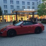 Front entrance of hotel ... nice car !