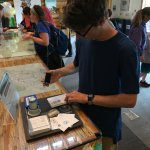 Collecting stamps in his National Parks passport