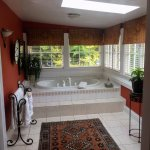 Persia Room jacuzzi with windows to view back yard garden area