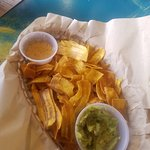 Plantain chips, guacamole, and the secret garlic sauce.
