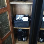 A cute little cupboard held coffee, hairdryer, and littler extras in the bathroom :)