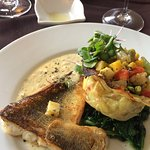 Pickerel with Yukon gold basket, filled with vegetables, wilted spinach