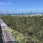 Cocoa beach has soft white sands and warm waters.