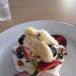 Crisp meringue filled with fresh berries, banana, passionfruit and cream