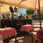 Pleasant outdoor seating facing Varenna's town center at Albergo Del Sole