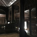"""A """" kit """" temple on very impressive stilts , showings its age , bats are interesting"""