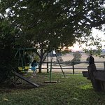 Eldest daughter playing on swing while waiting for sunrise