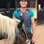 All smiles after ride--Under 16 legally have to wear vest (provided by stable)