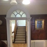 Lovely Georgian entrance hall with wood panelling.