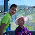 Riding with his 96yr old great grandmother up the gondola.