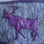 Purple Caribou room - throw on chair