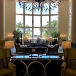 Tasteful, grand, and comfortable lobby with a magnificent view of the grounds and beachfront