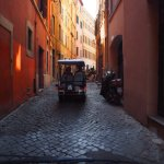 Golf Cart Tour heading down narrow Rome streets.