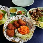 Fresh Fish cakes, delicious prawns and sausages made to an Isan recipe .