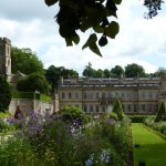 Rear view of Dyrham Hall with present gardens and parish church