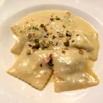 The daily 'special' cheese ravioli pasta dish with crumbled pistachio nuts
