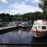 Boats for Dells Boat Tours (white and blue boats)