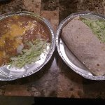 carnitas burrito and side of refried beans