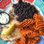 Grilled grouper, black beans & rice, sweet potato waffle fires.